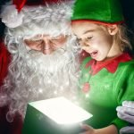 girl opening a gift with santa