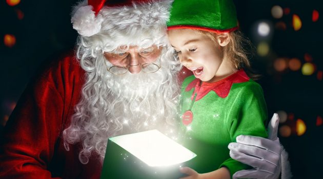 Santa with a little girl opening a gift